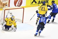 Finlands Sakari Manninen avgör i förlängningen med 5-4 målet.