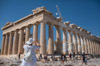 Turister i Aten förra året. Arkivbild.