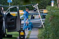 Polis och kriminaltekniker på plats efter att två människor skjutits ihjäl i en svenskregistrerad bil i Köpenhamnsförorten Herlev på tisdagskvällen.