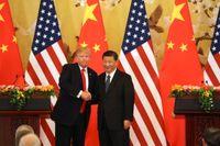 Donald Trump och Xi Jinping vid en gemensam presskonferens i Folkets stora hall på västra sidan av Himmelska fridens torg i Peking.