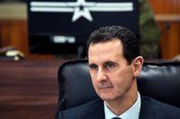 Syriens president Bashar al-Assad lyssnar till sin ryske motsvarighet Vladimir Putin under ett möte i Damaskus i januari.