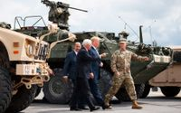 """Vice President Mike Pence, President Donald Trump and Maj. Gen. Walter Piatt arrive to view air assault exercises at Fort Drum, N.Y., Monday, Aug. 13, 2018, before a signing ceremony for H.R. 5515, the """"John S. McCain National Defense Authorization Act for Fiscal Year 2019."""""""