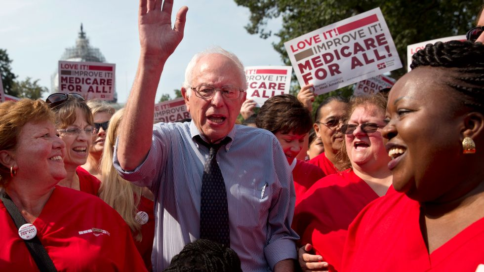 Democratic presidential candidate Sen. Bernie Sanders waves after speaking at a rally with registered nurses and other community leaders celebrate the 50th anniversary of Medicare and Medicaid, on Capitol Hill Washington.