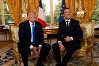 Frankrikes president Emmanuel Macron (till höger) och USA:s president Donald Trump, som är på besök i Paris.