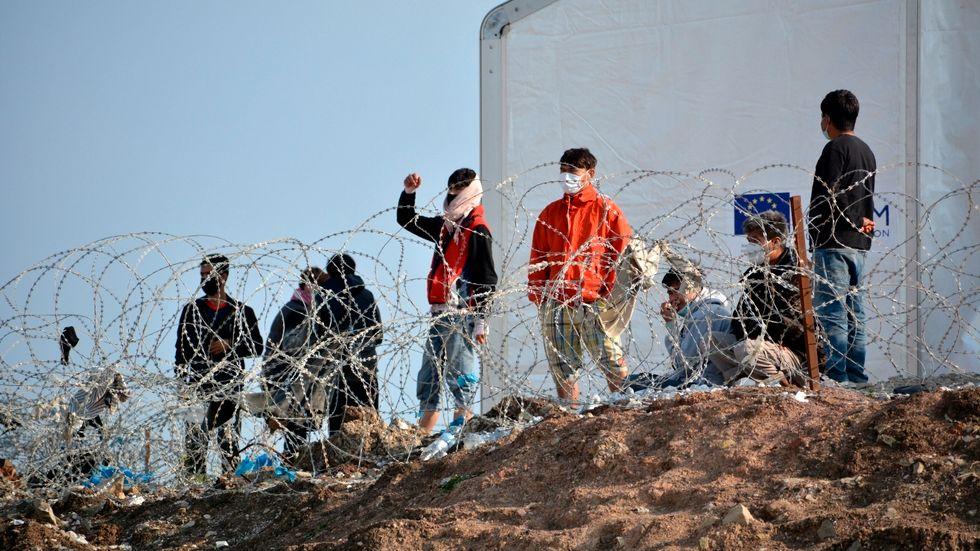 Migranter i et flyktingläger på ön Lesbos i Grekland. Bild från i mars i år.