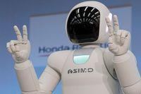En Honda-producerad Asimo-robot gläds å sina börskollegors vägnar. Illustrationsbild.