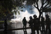 Kravallpolis i Santiago i lördags.