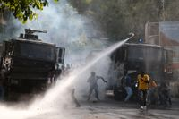 Demonstranter och polis drabbade samman i Port-au-Prince.