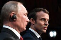 Vladimir Putin och Emmanuel Macron.