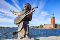 """Evert Taube är en många kända trubadurer som är företrädda i """"En svensk visbok""""."""