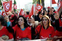 Tunisiska kvinnor firar Internationella kvinnodagen den 8 mars 2014.