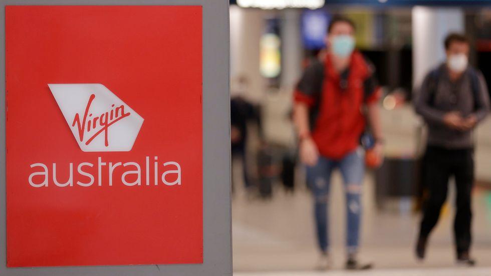 Passagerare vid Sydneys flygplats. Arkivbild.