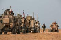 Amerikanska militärfordon i norra Syrien på söndagen. Arkivbild.