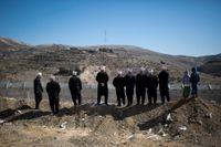En grupp druser protesterar mot Israels ockupation av Golanhöjderna i februari 2014. Runt 20000 druser bor i området, och många av dem identifierar sig fortfarande som syrier. Arkivbild.