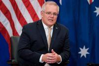 Australiens premiärminister Scott Morrison, här under ett möte med USA:s president Joe Biden tidigare i veckan, kan räkna med en faktura från franska ubåtstillverkaren Naval Group efter det brutna avtalet.