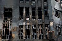 En förstörd byggnad som satts i brand under protesterna i Iran. Arkivbild.
