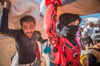 Över 150 000 kurder har flytt de senaste dagarna. Många kommer till gränsen vid Yamurtalik.