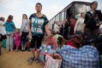 Ukrainska flyktingar i ett ryskt flyktingläger nära den ukrainska gränsen.
