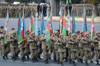 Azeriska trupper marscherar under en militärparad i Baku i veckan, för att fira fredsavtalet med Armenien kring Nagorno-Karabach.