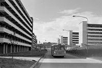 Buss kör längs nyuppförda Tensta allé, 1971.