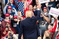 Supportrar till Donald Trump under ett kampanjmöte i februari.