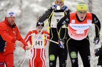 Anders och Jörgen Aukland får dricka efter Evertsbergssjöarna i spåret mellan Sälen och Mora i Vasaloppet 2008.