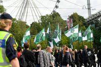 Nordiska motståndsrörelsen marscherade med plakat och flaggor i en tillståndslös demonstration i centrala Göteborg den 17 september.