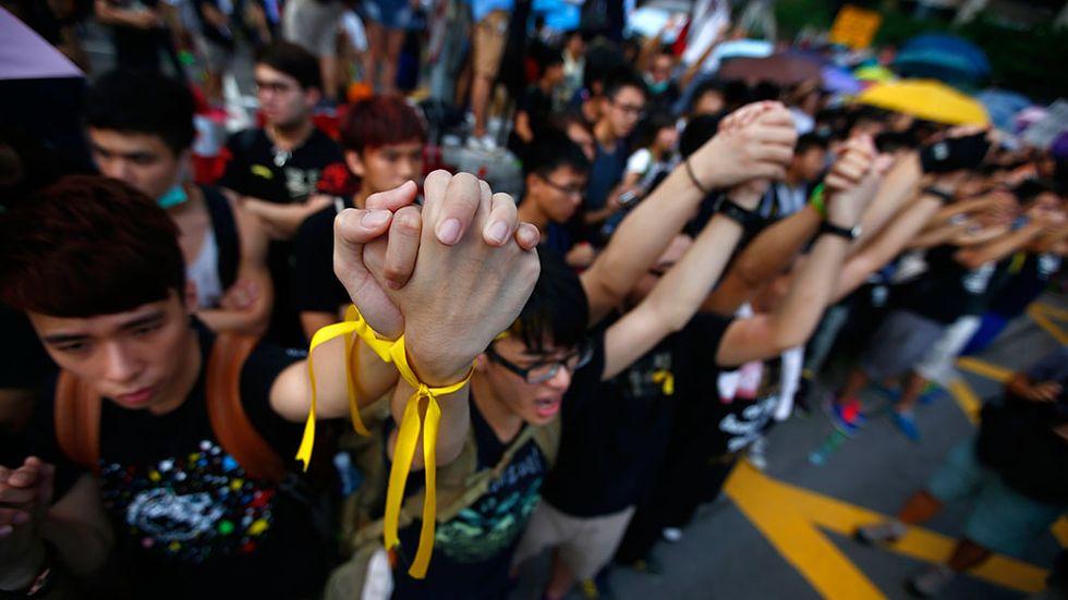Demonstrationerna mot den kinesiska regeringen fortsätter i Hongkongs finanskvarter. Men få bedömare tror att demokratirörelsen kan skada finansbranschen allvarligt.