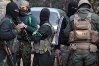 Anhängare till Hayat Tahrir al-Sham i Idlib i nordvästra Syrien. Arkivbild.