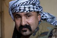 Shejk Qatari al-Obeidi leder en milisgrupp som slår till mot IS celler i Iraks vida ökenområden. Men den upptrappade konflikten mellan USA och Iran har i stort satt stopp för det arbetet.