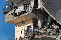 El-Yazje familjens hus i Gaza city inspekteras efter en israelisk missilattack.