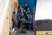 Några av de 47 aktivisterna som står inför rätta i Hongkong.