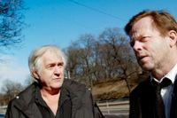 Henning Mankell och Krister Henriksson i april 2011.