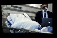 Huvudmisstänkte Abderrahman Mechkah medverkade via en videolänk från sjukhuset där han vårdas för sina skottskador.