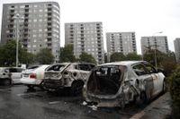 Utbrända bilvrak i Frölunda i augusti.