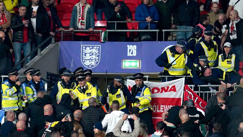 Supportrar på Ungerns läktarsektion drabbade samman med publikvärdar och polis på Wembley.