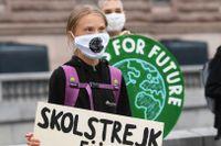 Klimataktivisten Greta Thunberg strejkar utanför Riksdagshuset i Stockholm i början på september.