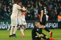 Romelu Lukaku och Marcus Rashford firar det omdiskuterade straffmålet som tog Manchester United till kvartsfinal i Champions League.