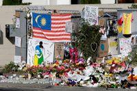 Blommor och ljus utanför en moské i Christchurch efter dådet i mars. Arkivbild.