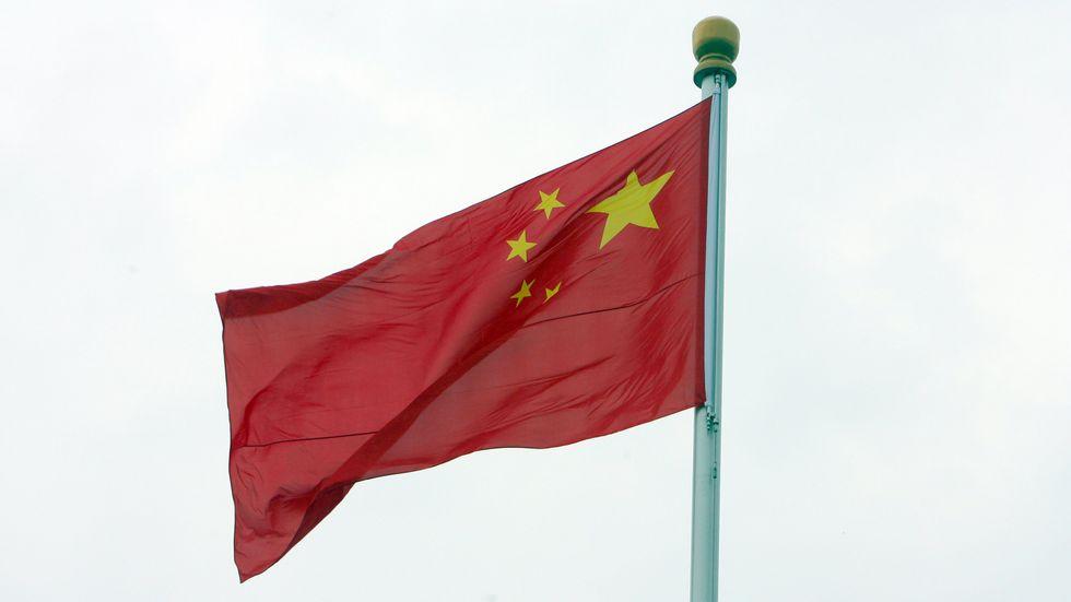 Kinesiska flaggan vajar över Himmelska fridens torg.