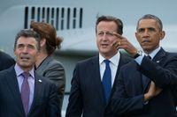 Natos generalsekreterare Anders Fogh Rasmussen, storbritanniens premiärminister David Cameron och USA:s president Barack Obama vid fredagens NATO-toppmöte.