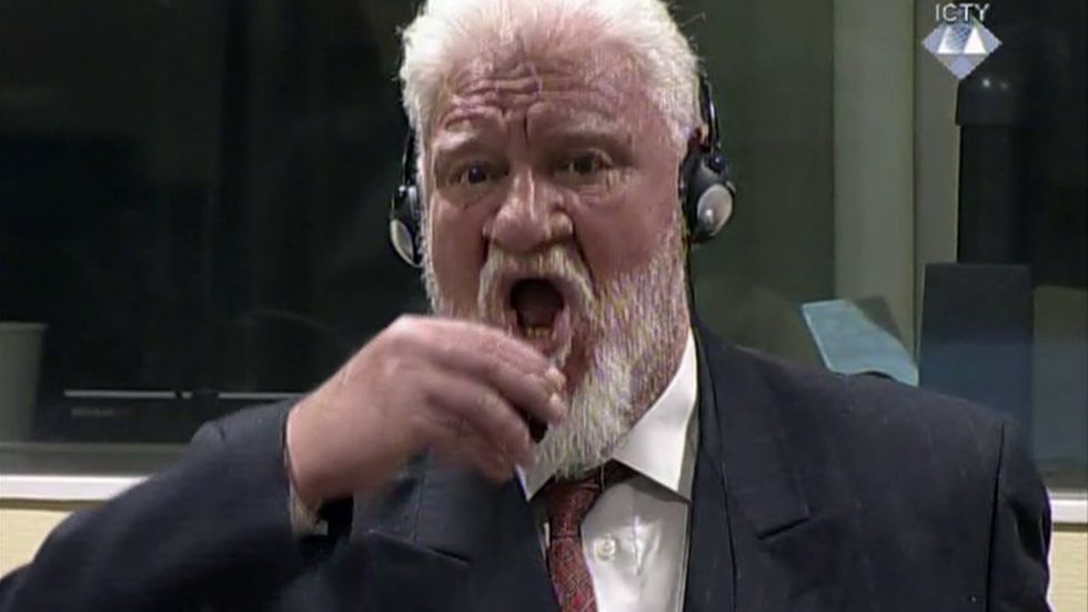 Slobodan Praljak brings a bottle to his lips, during a Yugoslav War Crimes Tribunal in The Hague, Netherlands. Praljak died after apparently taking poison at the United Nations tribunal. After nearly a quarter century of prosecuting Balkan wars atrocities, the United Nations Yugoslav war crimes tribunal is closing down with no fugitives left on the run, many major suspects convicted but denial of crimes and glorification of war criminals still rife in the region.