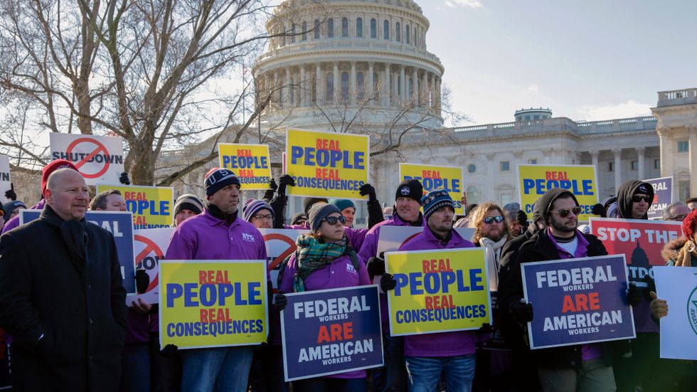 On the 20th day of a partial government shutdown, federal employees rally at the Capitol to protest the impasse between Congress and President Donald Trump over his demand to fund a U.S.-Mexico border wall, in Washington, Thursday, Jan. 10, 2019
