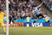 Edinson Cavani var på strålande spelhumör när Uruguay slog ut Portugal med 2–1 i åttondelsfinalen av fotbolls-VM.