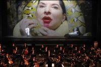 """Marina Abramovic som Desdemona, här strypt av en pytonorm, i """"The 7 deaths of Maria Callas""""."""